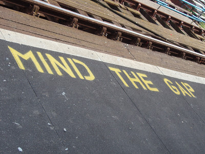 mind the gap road sign