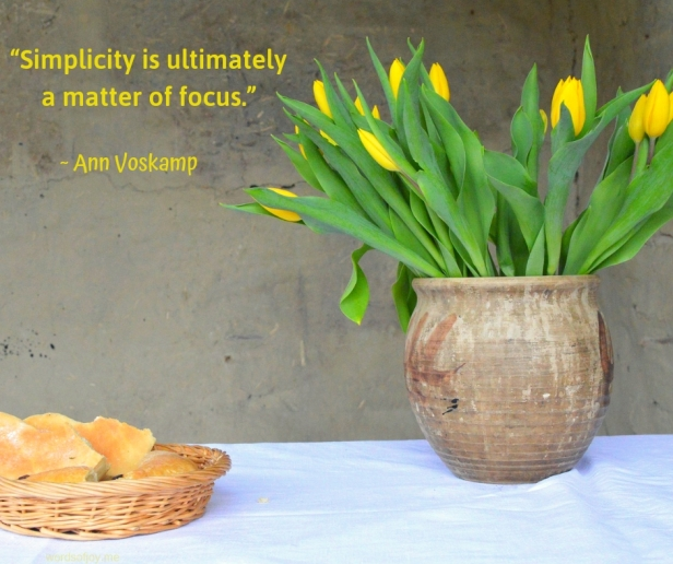 simplicity - table - bread - daffodils -Simplicity is ultimately a matter of focus quote by Ann Voskamp @wordsofjoy.me