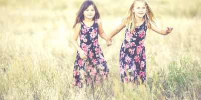 two girls playing in a field - girls just wanna have fun - @wordsofjoy.me
