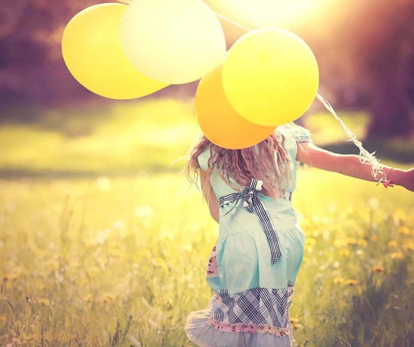 joy - discerning fake, festive and faith experiences - image of girl with balloons @wordsofjoy.me