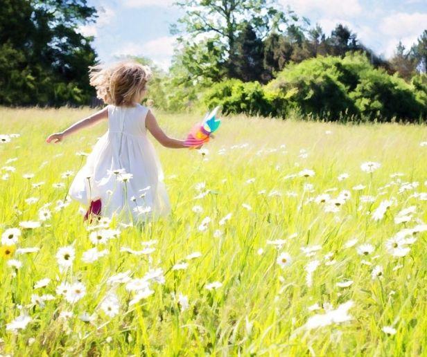 past - girl running over grass in summer @joylenton.com